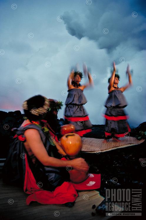 Traditional hula to volcano goddess Pele as lava enters the sea, Big Island