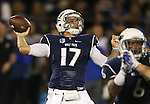 Nevada's Cody Fajardo (17) throws a pass against Boise State during the first half of an NCAA college football game in Reno, Nev, on Saturday, Oct. 4, 2014. (AP Photo/Cathleen Allison)