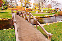 The Brewster Gardens in Plymouth on a gloomy day in fall. Partial view of the Garden with the little wooden bridge and the creek on the foreground