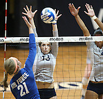 Nevada's Donna Greely (13) and Tessa Lea'ea (6) block against Air Force's Maggie Sherrill (21) during college volleyball action in Reno, Nev., on Thursday, Sept. 25, 2014. Air Force won 3-2.<br /> Photo by Cathleen Allison
