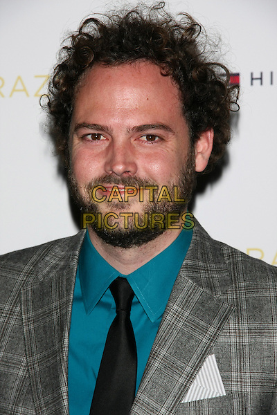 "Drake Doremus .The New York Premiere of ""Like Crazy"" at the Landmark Sunshine Cinema, New York, NY, USA..October 18th, 2011.headshot portrait grey gray check suit blue shirt black tie beard facial hair .CAP/LNC/TOM.©TOM/LNC/Capital Pictures."