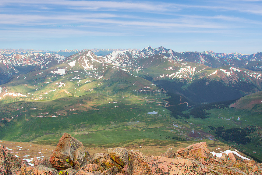 From the summit of Mount Bierstadt (14,065 feet), this is the view of the Colorado landscape as you look towards Grays Peak and Torreys Peak. The now was still around in late June, but the views from the top were incredible.