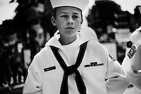 Young boys dressed in naval uniforms wait to march in the 4th of July Parade in Amherst, New Hampshire. Republican presidential candidates Mitt Romney and Jon Huntsman walked in the parade as part of their campaign for the 2012 presidential election.