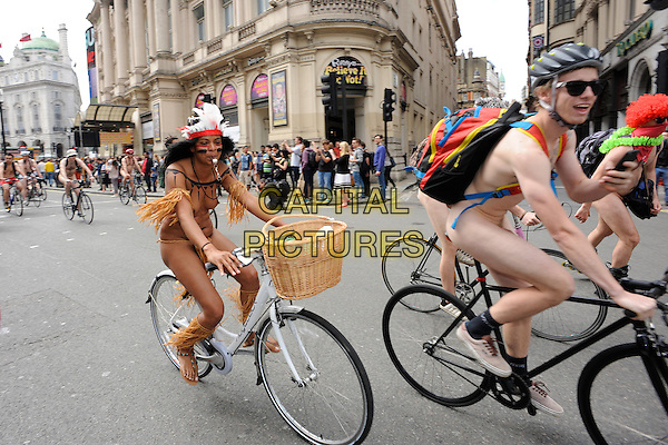 LONDON, UNITED KINGDOM- JUNE 14; people take part in the annual ' London world Bike Ride' event in central London on June 14, 2014 in London, England LONDON, UNITED KINGDOM - JUNE 14: People take part in the annual 'London World Naked Bike Ride' event in central London on June 14, 2014 in London, England.<br /> CAP/IA<br /> &copy;Ian Allis/Capital Pictures