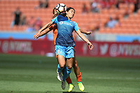 Houston, TX - Saturday May 13, 2017: Sky Blue FC midfielder Raquel Rodriguez (11) heads the ball in front of Houston Dash midfielder Amber Brooks (12) during a regular season National Women's Soccer League (NWSL) match between the Houston Dash and Sky Blue FC at BBVA Compass Stadium. Sky Blue won the game 3-1.