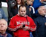 Fan looks at his phone during the Championship League match at Bramall Lane Stadium, Sheffield. Picture date 19th August 2017. Picture credit should read: Simon Bellis/Sportimage