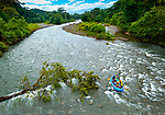 Tourists enjoy the adventure of white water rafting on the Sarapiqui River in northeastern Costa Rica.  Nature reserves and eco lodges have developed around the river due to its lowlands tropical rainforest and large variety of plant, animal and insect life.