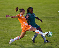 Sky Blue FC midfielder Collette McCallum (14) and Saint Louis Athletica forward Enoila Aluko (9) during a WPS match at Anheuser Busch Soccer Park, in St. Louis, MO, July 22 2009. Athletica won the match 1-0.