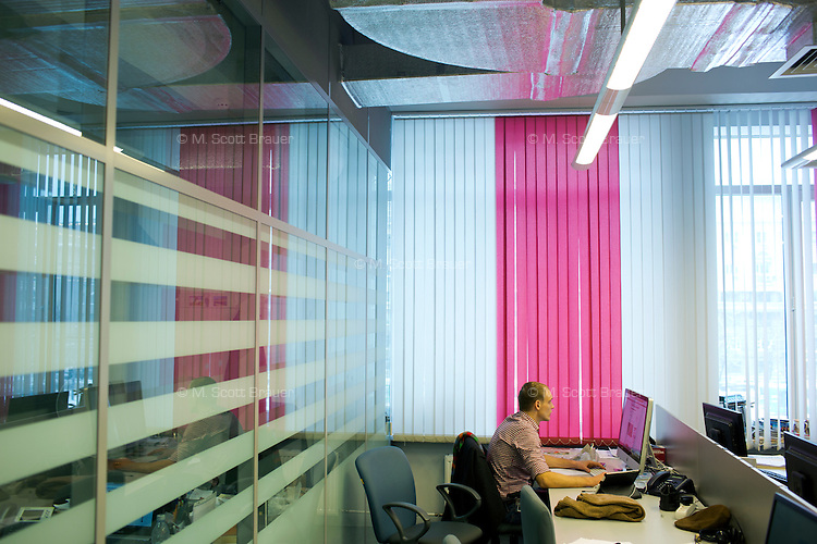 Reporters and editors work in the editorial offices of Vechernyaya Moskva (Evening Moscow) in Moscow, Russia.