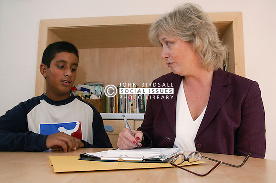 Boy in consultation with adult woman,