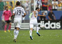 CARSON, CA - DECEMBER 01, 2012:   Juninho (19) of the Los Angeles Galaxy watches  Landon Donovan (10) pick up a pass against the Houston Dynamo during the 2012 MLS Cup at the Home Depot Center, in Carson, California on December 01, 2012. The Galaxy won 3-1.