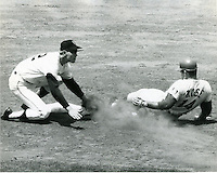 Cincinnati Reds Pete Rose steals 2nd base, San Francisco Giants shortstop Hal Lanier attempts tag.<br />