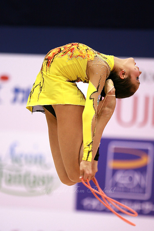Aliya Garaeva competing for Azerbaijan performs ring leap with rope at 2006 Aeon Cup Worldwide Club Championships in rhythmic gymnastics on November 19, 2006 at Mie, Japan.  &amp;#xA;<br />