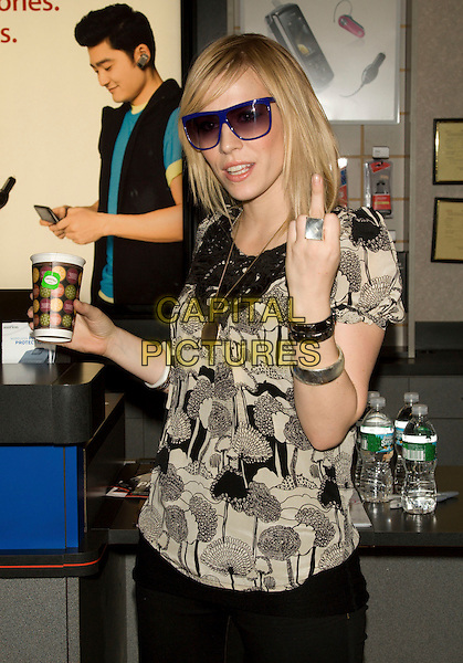 NATASHA BEDINGFIELD.Verizon VIP Tour Meet-n-Greet.at the Verizon Wireless Store in Soho, New York, NY, USA, June 25, 2008..half length black and cream print top cup drink ring bracelets finger swearing blue sunglasses.CAP/LNC/TOM.©LNC/Capital Pictures