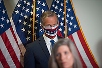United States Senator John Thune (Republican of South Dakota), watches as United States Senator Joni Ernst (Republican of Iowa), offers remarks following the GOP luncheon in the Hart Senate Office Building on Capitol Hill in Washington, DC., Tuesday, September 15, 2020. <br /> Credit: Rod Lamkey / CNP /MediaPunch