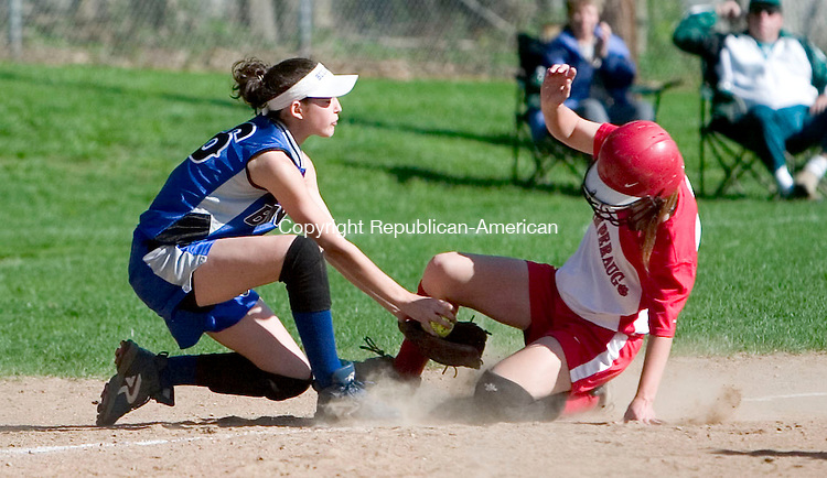 SOUTHBURY, CT- 04 MAY 07- 050407JT04-<br /> Pomperaug's Julie Baczeski safely slides into third as Bunnell's Lindsay Lanteri covers the bag at Friday's game at Community Field in Southbury.<br /> Josalee Thrift Republican-American