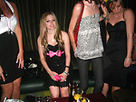 5-8-09.Exclusive.Avril Lavigne partying with Ernest Hemingway's grand daughter at a club called Echo in Hollywood ca.  Wearing a  Pink bow tie and black dress...AbilityFilms@yahoo.com.805-427-3519.www.AbilityFilms.com.