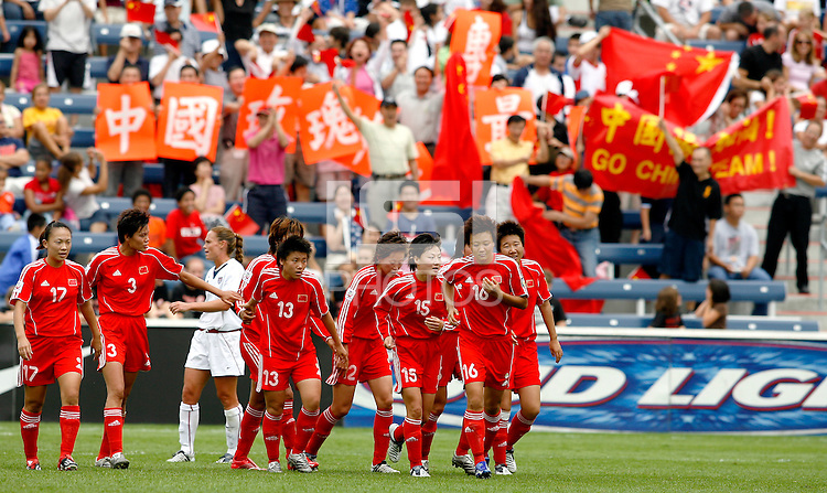 Chinese players and fans celebrate Han Duan's (10) goal.  The U.S. Women's National Team defeated China 4-1 at Toyota Park in Bridgeview, IL on August 28, 2006.