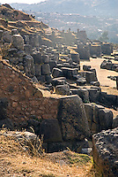 Located on a steep hill that overlooks the Cusco, the former Inca capital city, Sacsayhuaman is a large complex of large polished dry-stone walls intricately crafted with huge boulders. The best-known area of Sacsayhuaman is the great plaza and its adjacent three massive terrace walls.