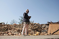 An old man stands in front of his collapsed house at Dhulikhel, outstrike of Kathmandu, Nepal. May 1, 2015