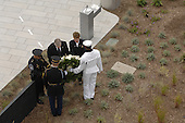 Arlington, VA - September 11, 2008 -- Retired United States Air Force General Richard B. Myers, former chairman of the Joint Chiefs of Staff; American Airlines flight attendant Deborah Maitland-Rowland; and Lieutenant David Webster, a Pentagon Force Protection Agency officer, place a wreath at the Pentagon Memorial Sept. 11, 2008, during its dedication ceremony. The memorial consists of 184 inscribed memorial units honoring the 59 people aboard American Airlines Flight 77 and the 125 in the Pentagon who lost their lives Sept. 11, 2001. .Credit: Jennifer Villalovos - DoD via CNP