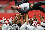 Swansea manager Brendan Rodgers is hoisted aloft by his players after the Npower Championship play-off final between Reading (blue) and Swansea City at Wembley Stadium. The match was won by Swansea by 4 goals to 2 watched by a crowd of 86,581. Swansea became the first Welsh team to reach the top division of English football since they themselves played there in 1983.