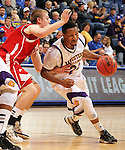 SIOUX FALLS, SD - MARCH 9:  Remy Roberts-Burnett #24 from Western Illinois drives against Casey Kasperbauer #14 from the University of South Dakota in the first half of their quarterfinal game Saturday evening at the 2013 Summit League Basketball Tournament in Sioux Falls, SD.  (Photo by Dave Eggen/Inertia)