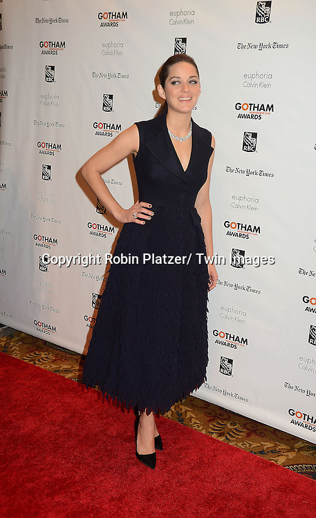 Marion Cotillard in black  Dior dress and Chopard jewelry attends the 22nd Annual IFP Gotham Independent Film  Awards on November 26, 2012 at Cipriani Wall Street in New York City.