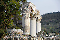 A detail of Temple E, on April 15, 2007 in Corinth, Greece. Origonally built during the early Augustan period, 1st century BC, Temple E was rebuilt after the earthquake of 77 AD. These three fine Corinthian capitals and columns, two of which have been reconstructed, are seen in the afternoon light. Corinth, founded in Neolithic times, was a major Ancient Greek city, until it was razed by the Romans in 146 BC.