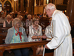 Canon Patsy McDonnell meets with Sr. Monica Taggart and Breda Mcevoy in St. Peters church. They were at his first mass 60 years ago. Photo:Colin Bell/pressphotos.ie