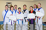 INSTRUCTORS CERTS: The first Irish students to receive their Han Moodo instructors certs and belt grading at CWS complex, Tralee on Sunday l-r: Michael Kelliher, Maja Noszczyk, Phil Horgan, Phil (jnr) Horgan, Young Suk, Jia O'Connell, Bryan Scanell and Michael O'Connell.