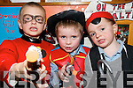 MEN AT WAR: Stephen O'Carroll, Dillon Browne and Jeremiah O'Neill checking out their props during Book Day at Ballyduff Central National School on Thursday last.
