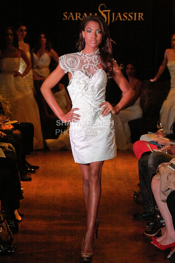 Model walks the runway in a Bijou wedding dress - short beaded silk satin cocktail dress with halter, by Sarah Jassir, for the Sarah Jassir Couture Bridal Fall 2012 Opulence collection.