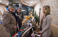 NWA Democrat-Gazette/BEN GOFF @NWABENGOFF<br /> Susan Zeh (from left) and husband Bruce Zeh of Bentonville look at some of Beth Lenderman's paintings Thursday, Nov. 8, 2018, at Hark &amp; Herald Collaborative Space during the 'Light Up the Night!' one year anniversary Art on the Bricks art walk in downtown Rogers. More than 25 artists and musicians opened pop-up galleries selling their artwork at downtown shops and restaurants. Go Downtown Rogers hosts the walks on the second Thursday of each month.
