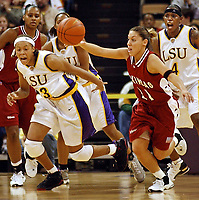 Arkansas' India Lewis, right, steals the ball from Louisiana State's Seimone Augustus, left, during the first half Thursday, Feb. 27, 2003, in Baton Rouge, La. LSU's Doneeka Hodges is at background right. (AP Photo/Bill Feig)