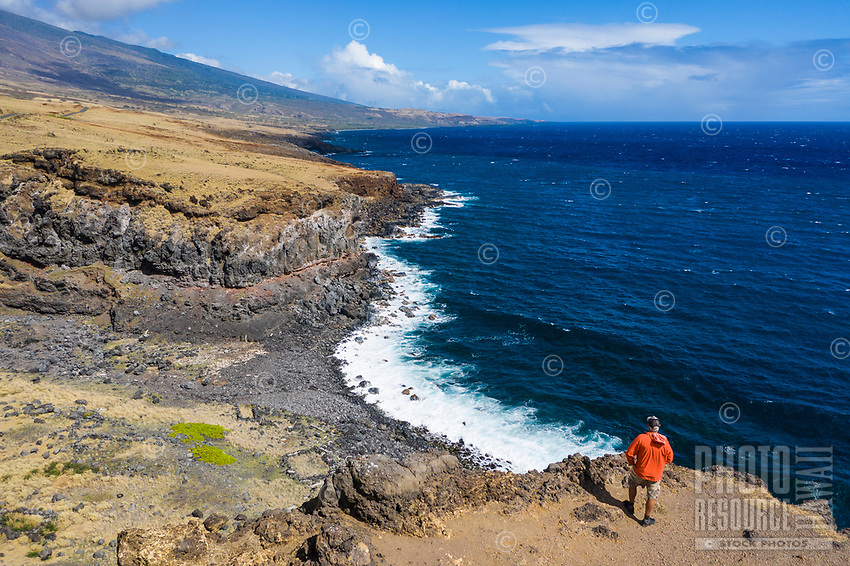 A man looks out at the coastline along Piilani Highway in Kaupo, Maui.
