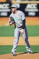 Marshall Thundering Herd relief pitcher Alex Thackston (18) looks to his catcher for the sign against the Georgetown Hoyas at Wake Forest Baseball Park on February 15, 2014 in Winston-Salem, North Carolina.  The Thundering Herd defeated the Hoyas 5-1.  (Brian Westerholt/Four Seam Images)