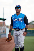 Tampa Tarpons Daniel Barrios (10) walks to the dugout before a game against the Bradenton Marauders on August 12, 2018 at LECOM Park in Bradenton, Florida.  The game was suspended in the bottom of the first inning due to weather.  (Mike Janes/Four Seam Images)