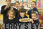 Pupils at Caherleaheen National School enjoying a coffee morning for parents and pubils at the school to raise funds for Haiti. .Front L-R  KIm Flannery, Ciara Sugrue and Anna Curtin, .Back L-R Christopher Rogers, Andrea Kearns and Hannah Dobbin.