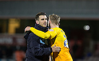 Matt Bloomfield of Wycombe Wanderers & Jason McCarthy of Wycombe Wanderers embrace on the final whistle during the Sky Bet League 2 match between Dagenham and Redbridge and Wycombe Wanderers at the London Borough of Barking and Dagenham Stadium, London, England on 9 February 2016. Photo by Andy Rowland.