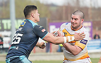 Picture by Allan McKenzie/SWpix.com - 25/03/2018 - Rugby League - Betfred Championship - Batley Bulldogs v Featherstone Rovers - Heritage Road, Batley, England - Jame Brown is tackled by Mitch Clark.