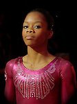 "United States gymnast Gabrielle Douglas enters the arena to begin the Women's Artistic Gymastics Individual All-Around Competition at the London Olympics on Thursday, August 2, 2012 in London, England. ""Gabby"" won the gold medal.  (AP Photo/Margaret Bowles)"