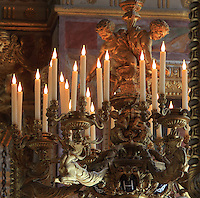 Chandelier with sculpted fawns and stags, made 1837 in gilded bronze by Charles Jules Inge, d.1843 and Louis Claude Ferdinand Soyer, 1785-1854, in the ballroom or Galerie Henri II, Chateau de Fontainebleau, France. The Palace of Fontainebleau is one of the largest French royal palaces and was begun in the early 16th century for Francois I. It was listed as a UNESCO World Heritage Site in 1981. Picture by Manuel Cohen
