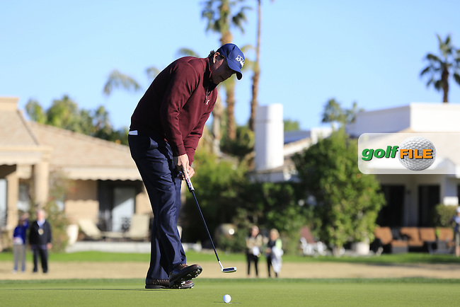Phil Mickelson (USA) sinks his birdie putt on the 16th green during Saturday's Round 3 of the 2017 CareerBuilder Challenge held at PGA West, La Quinta, Palm Springs, California, USA.<br /> 21st January 2017.<br /> Picture: Eoin Clarke   Golffile<br /> <br /> <br /> All photos usage must carry mandatory copyright credit (&copy; Golffile   Eoin Clarke)
