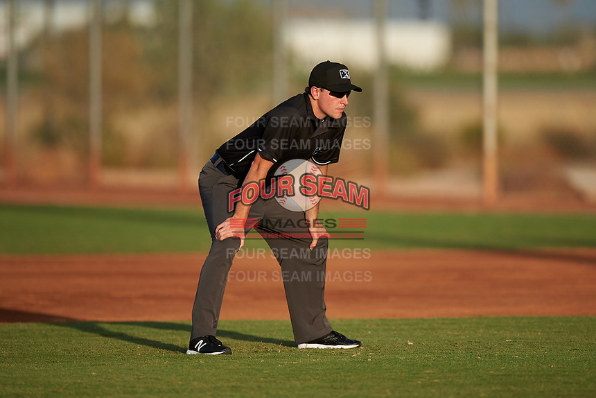 Umpire Tyler Wall during an Arizona League game between the AZL Athletics Green and AZL Reds on July 21, 2019 at the Cincinnati Reds Spring Training Complex in Goodyear, Arizona. The AZL Reds defeated the AZL Athletics Green 8-6. (Zachary Lucy/Four Seam Images)