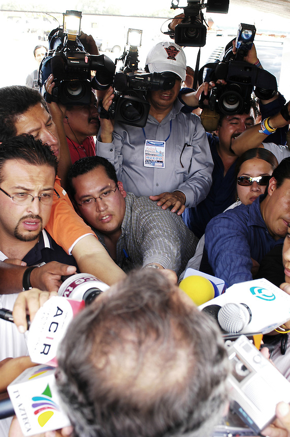 he press crowd around Felipe Calderon during a quick press confrence on the side of the road on his way to Tonala, Chiapas.  Calderon is surging ahead for the presidential race as the nominee of the PAN.