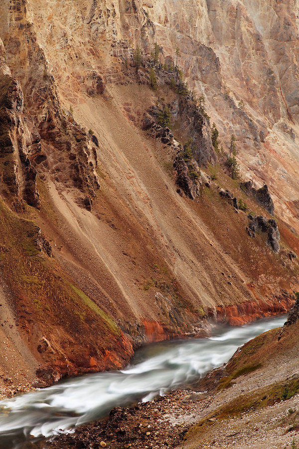 Detail of yellow cliffs above the Yellowstone River at bottom of Grand Canyon of the Yellowstone, Yellowstone National Park, Wyoming, USA