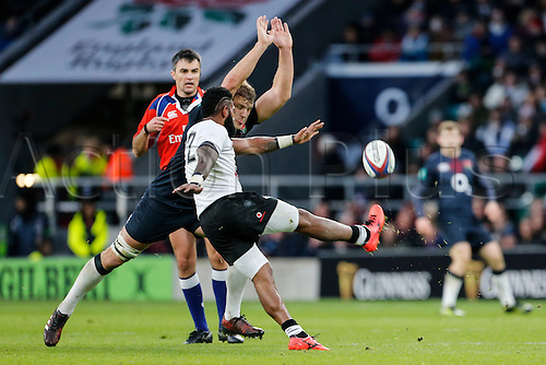 19.11.2016. Twickenham, London, England. Autumn International Rugby. England versus Fiji.  Nikola Matawalu of Fiji clears his lines as Joe Launchbury of England closes in.   Final score: England 58-15 Fiji.