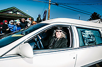 Rodney Richmond drives a hearse during the 18th Annual Frozen Dead Guy Days in Nederland, Colorado, Saturday, March 9, 2019. The festival takes place in the Colorado mountain town of Nederland and features three days of festivities including live music, coffin racing, costumed polar plunging and more. The festival pays homage to Bredo Morstol, who is frozen in a state of suspended animation and housed in a Tuff Shed on dry ice high above Nederland. <br /> <br /> Photo by Matt Nager