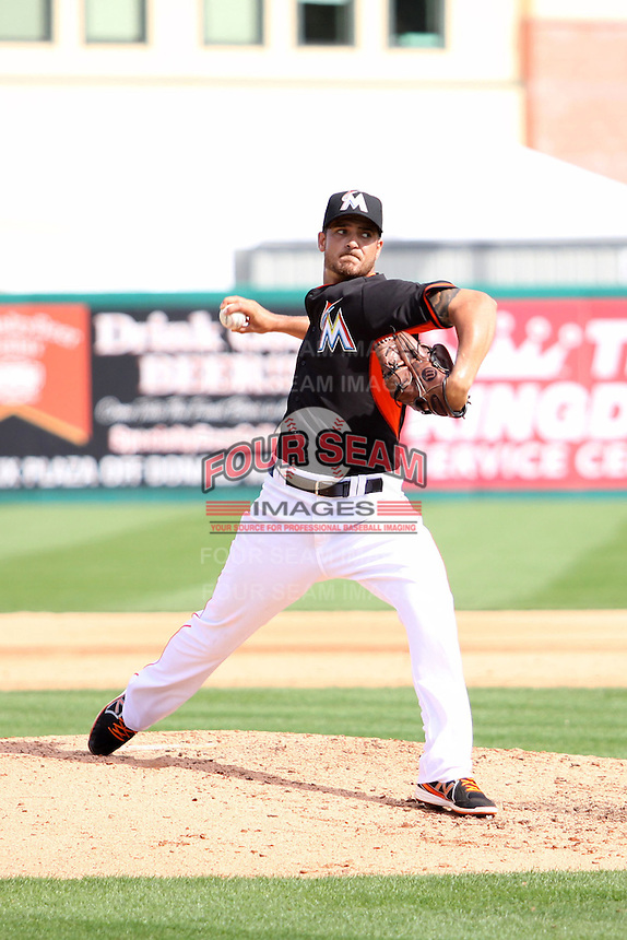 Andre Reinzo (25) throws a pitch for the Miami Marlins during a spring training game against the University of Miami Hurricanes at the Roger Dean Complex in Jupiter, Florida on March 3, 2015. Miami defeated UM 7-1. (Stacy Jo Grant/Four Seam Images)